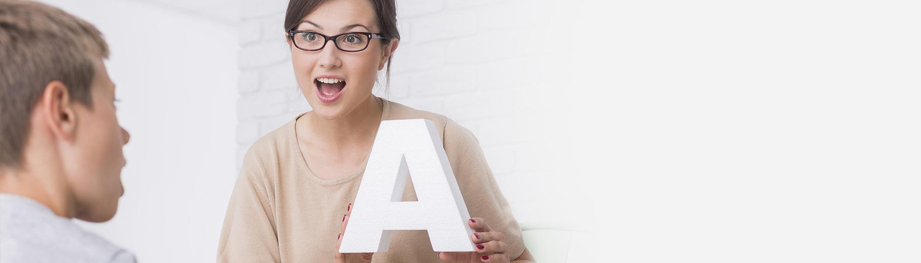 woman holding the letter a