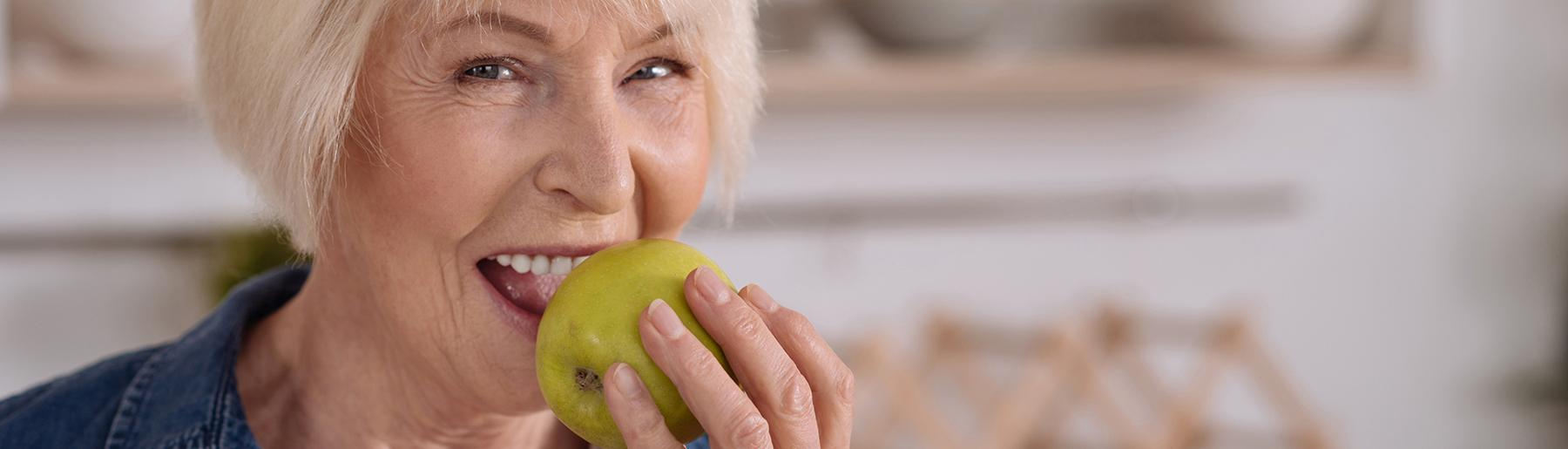 Woman biting in apple
